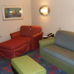 Living Area with convertible sofa, chair and ottoman