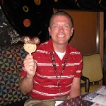 Steve holding a Mickey Rice Krispie treat on the Disney Wonder