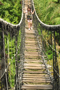 my daughter crossing one of the two suspension bridges