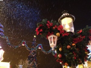 Snow falling on Main Street U.S.A.