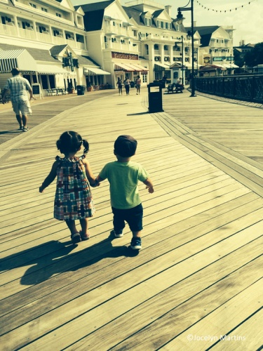 MMElliot and Sabrina holding hands at the Boardwalk