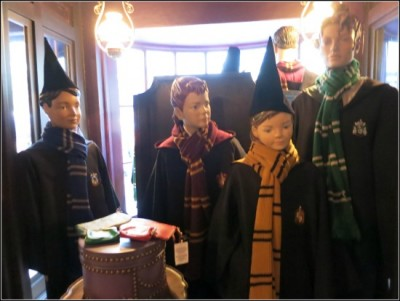 Young wizards model their school robes and scarves