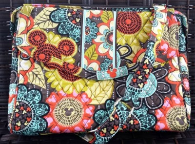 An iPad or small tablet will fit well in the Perfect Petals tablet hipster bag