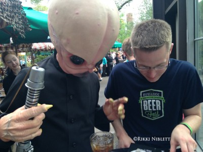 Cantina Band Member Helping Pick Dinner Options