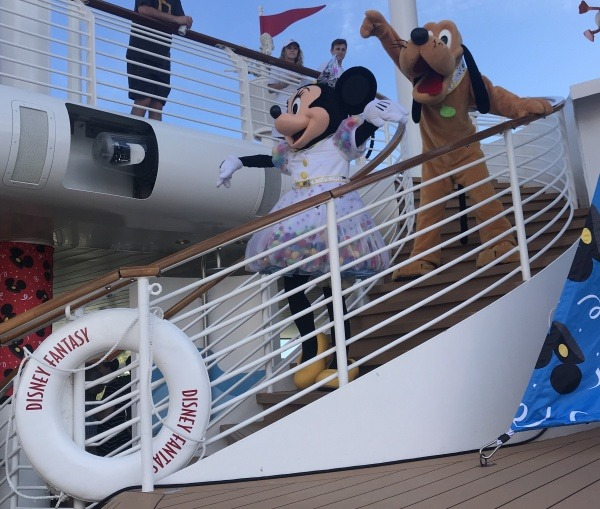 Minnie and Pluto get ready to surprise Mickey