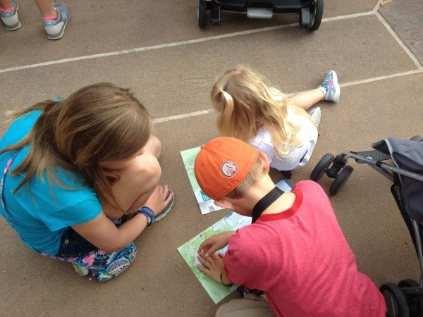 Kids plan day using maps from Walt Disney World