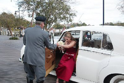 Eliza exits the limo