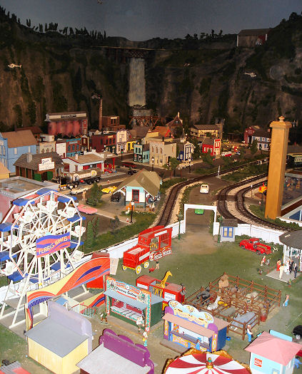 Model city and railroad inside of Amberville
